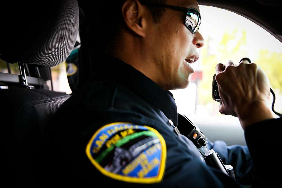 San Rafael Police officer Ed Chiu talks over the radio while on patrol in San Rafael. Photo: Gabrielle Lurie, The Chronicle