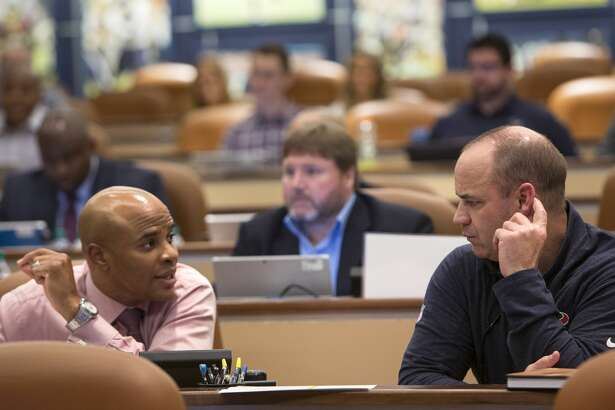 Houston Texans general manager Rick Smith, left, and head coach Bill O'Brien talk in the Texans draft room at NRG Stadium on Thursday, April 27, 2017, in Houston. ( Brett Coomer / Houston Chronicle )
