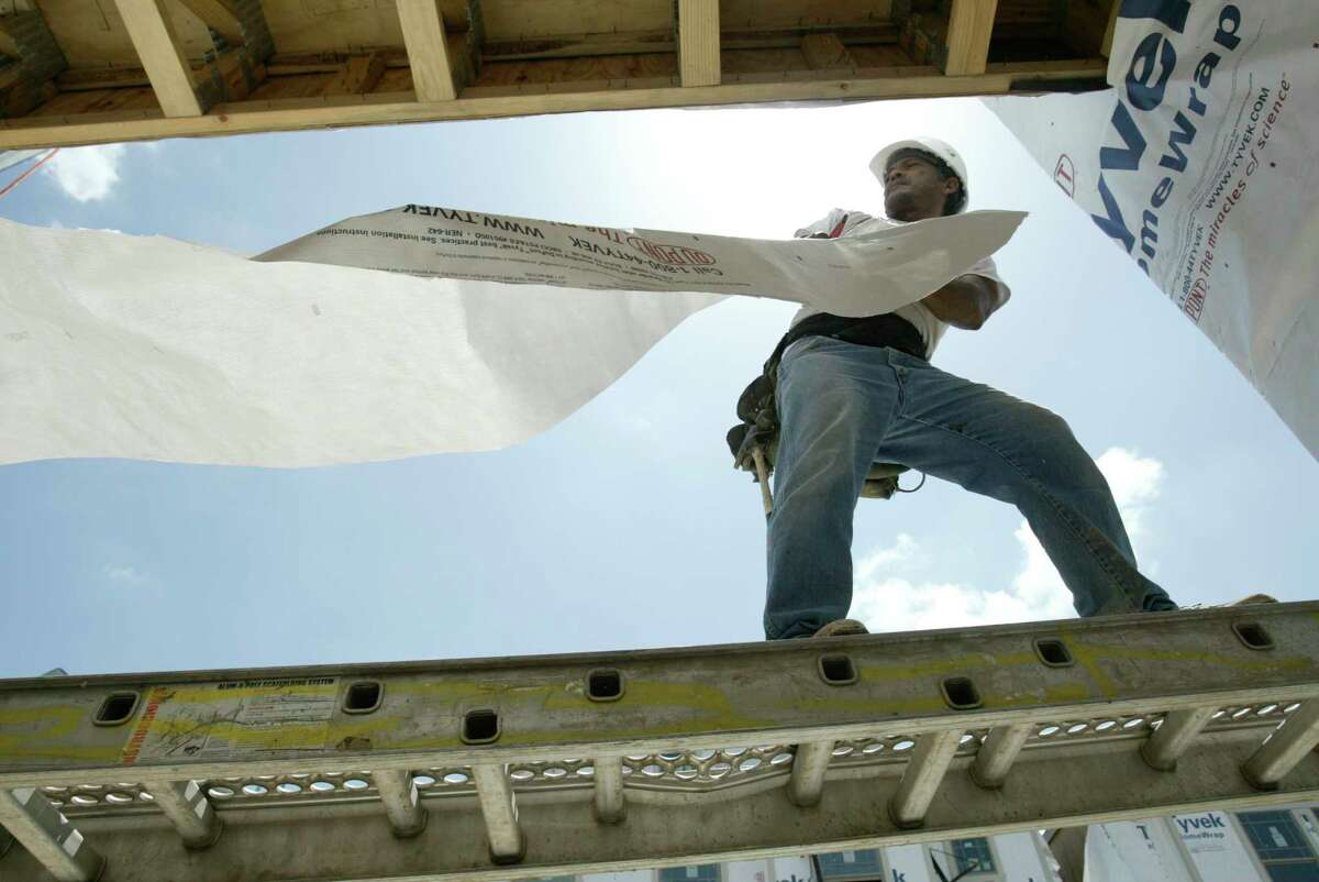 An undocumented employee works at a construction site in Houston. (Chronicle File Photo)
