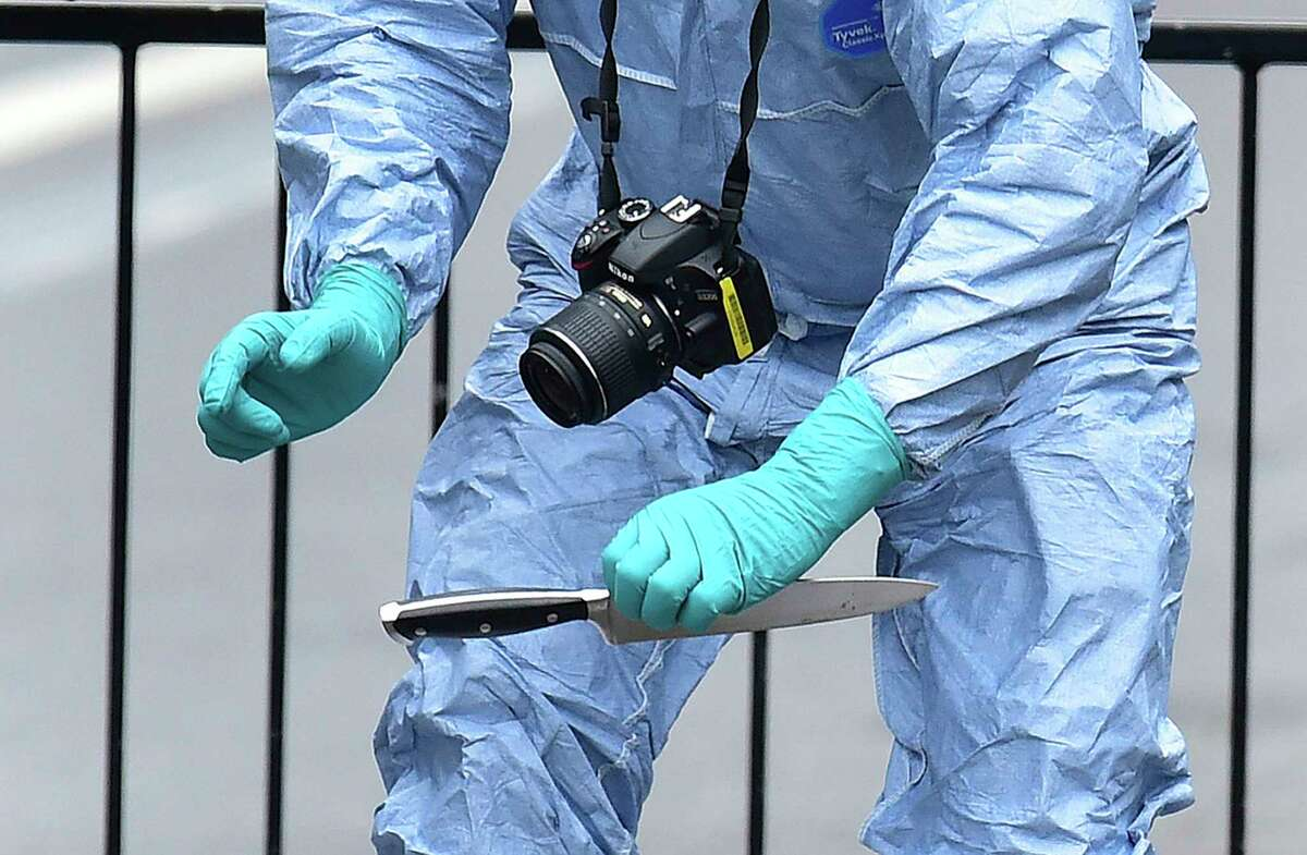 A police forensic Officer holds a knife at the scene after a man was arrested following an incident at Whitehall in London, Thursday April 27, 2017. London police arrested a man for possession of weapons Thursday near BritainÂ?'s Houses of Parliament. (Dominic Lipinski/PA via AP)