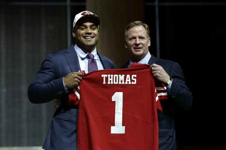 Stanford's Solomon Thomas, left, poses with NFL commissioner Roger Goodell after being selected by the San Francisco 49ers during the first round of the 2017 NFL football draft, Thursday, April 27, 2017, in Philadelphia.(AP Photo/Matt Rourke)
