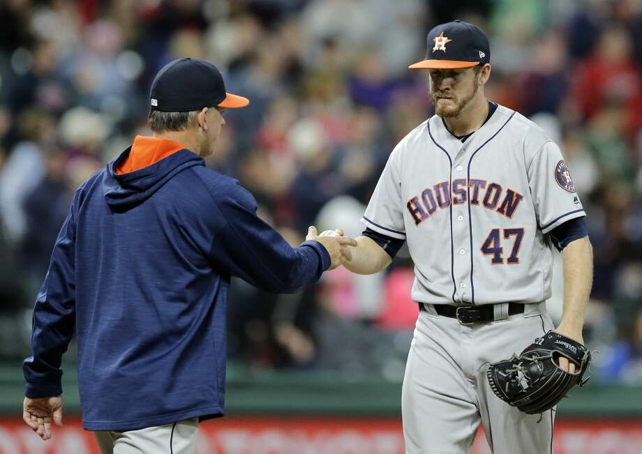 Houston Astros relief pitcher Chris Devenski, right, hands the ball off to manager A.J. Hinch during the seventh inning of the team's baseball game against the Cleveland Indians, Thursday, April 27, 2017, in Cleveland. (AP Photo/Tony Dejak) Photo: Tony Dejak/Associated Press
