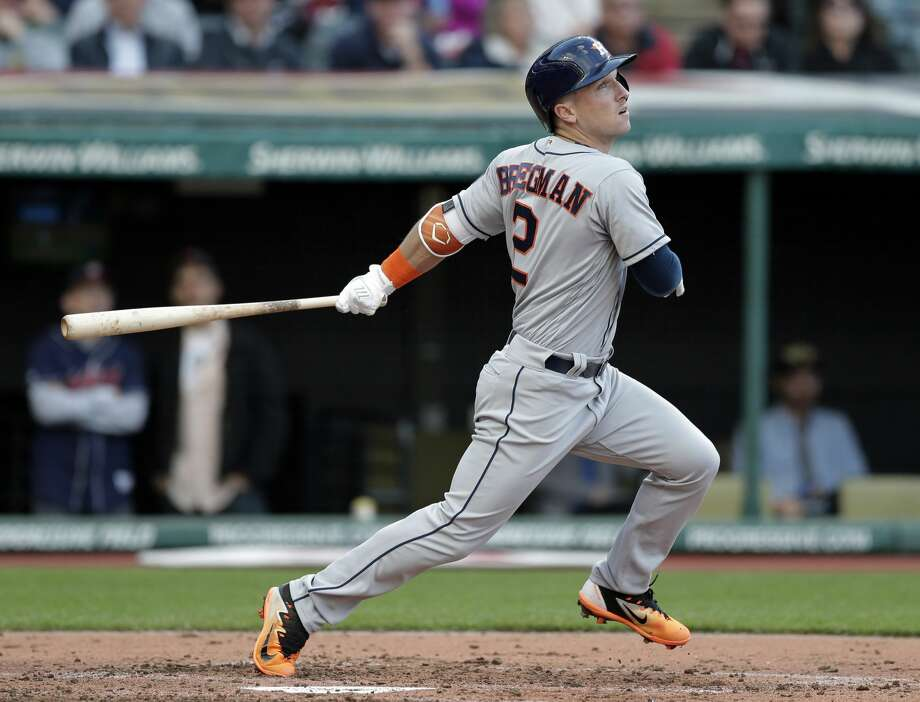 Houston Astros' Alex Bregman watches his RBI double off Cleveland Indians starting pitcher Corey Kluber duringp the third inning of a baseball game, Thursday, April 27, 2017, in Cleveland. Brian McCann scored on the play. (AP Photo/Tony Dejak) Photo: Tony Dejak/Associated Press
