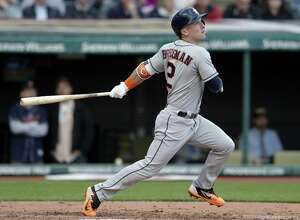 Houston Astros' Alex Bregman watches his RBI double off Cleveland Indians starting pitcher Corey Kluber duringp the third inning of a baseball game, Thursday, April 27, 2017, in Cleveland. Brian McCann scored on the play. (AP Photo/Tony Dejak)
