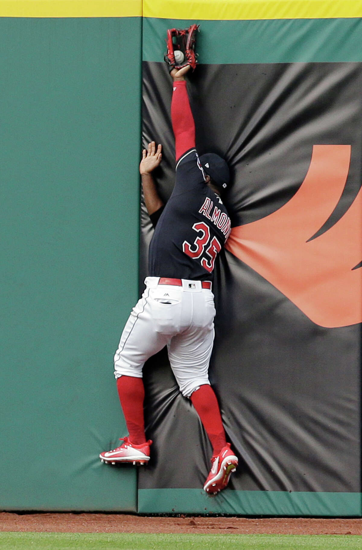 Cleveland Indians' Abraham Almonte reaches for a ball hit by Houston Astros' Yuli Gurriel during the first inning of a baseball game, Thursday, April 27, 2017, in Cleveland. Gurriel was out on the play. (AP Photo/Tony Dejak)