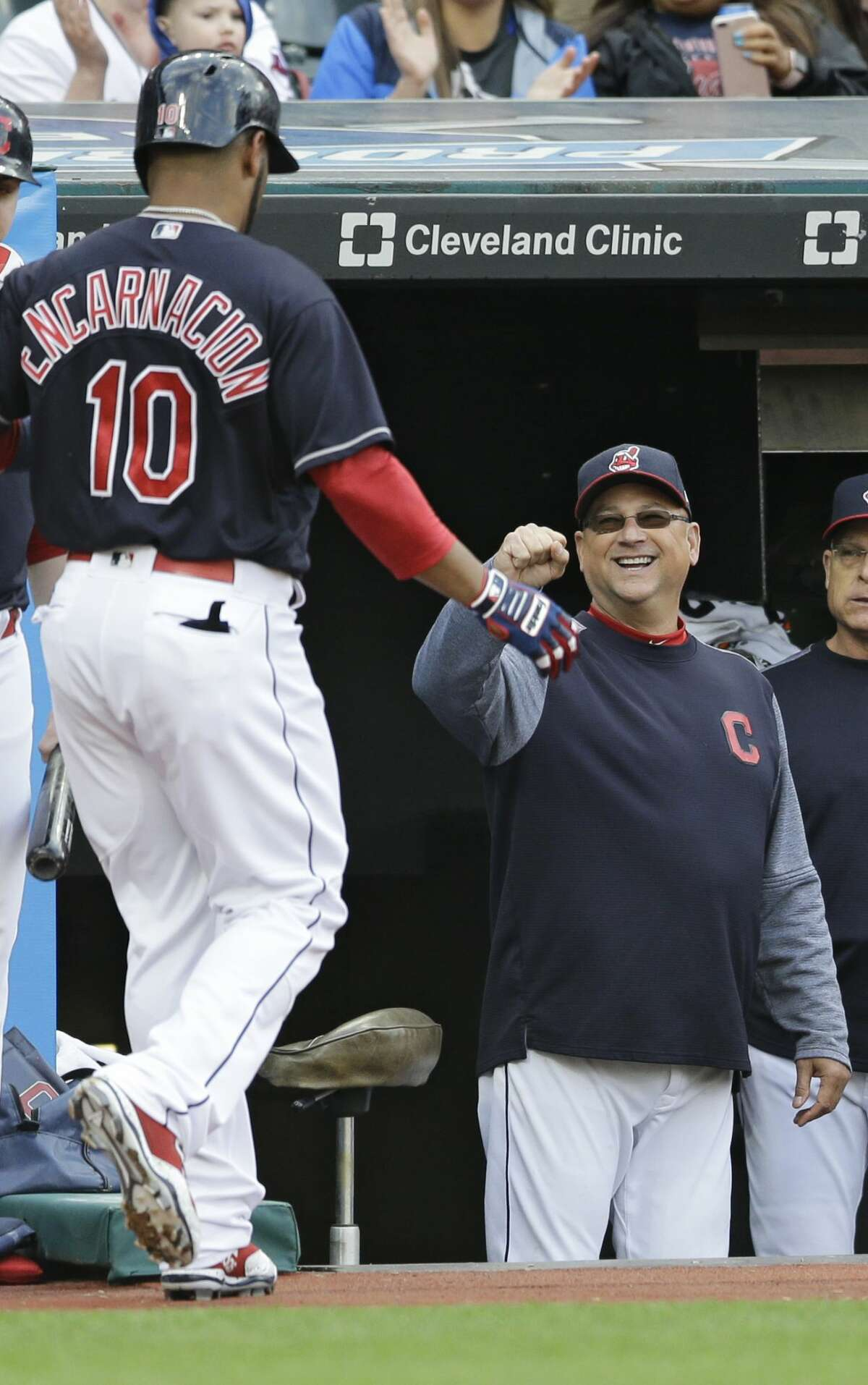 Cleveland Indians manager Terry Francona, right, congratulates Edwin Encarnacion after Encarnacion hit a solo home run off Houston Astros starting pitcher Mike Fiers in the second inning of a baseball game, Thursday, April 27, 2017, in Cleveland. (AP Photo/Tony Dejak)
