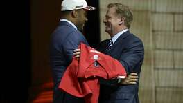 Stanford's Solomon Thomas, left, greets NFL commissioner Roger Goodell after being selected by the San Francisco 49ers during the first round of the 2017 NFL football draft, Thursday, April 27, 2017, in Philadelphia.(AP Photo/Matt Rourke)