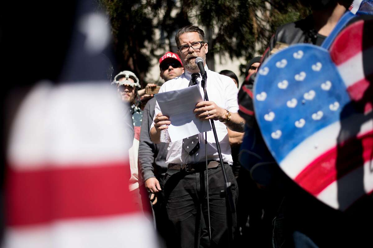 FILE -- Conservative speaker Gavin McInnes, co-founder of Vice Media, speaks during a rally at Martin Luther King Jr. Civic Center Park on Thursday, April 27, 2017, in Berkeley, Calif. McInnes founded the Proud Boys, a group which is suspected of being involved in melees over the weekend in New York and Portland, Ore.
