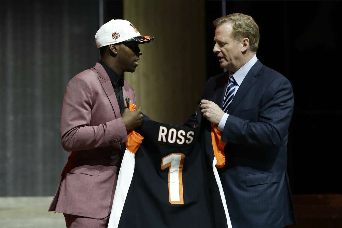 Washington's John Ross, left, greets NFL commissioner Roger Goodell after being selected by the Cincinnati Bengals during the first round of the 2017 NFL football draft, Thursday, April 27, 2017, in Philadelphia. (AP Photo/Matt Rourke)