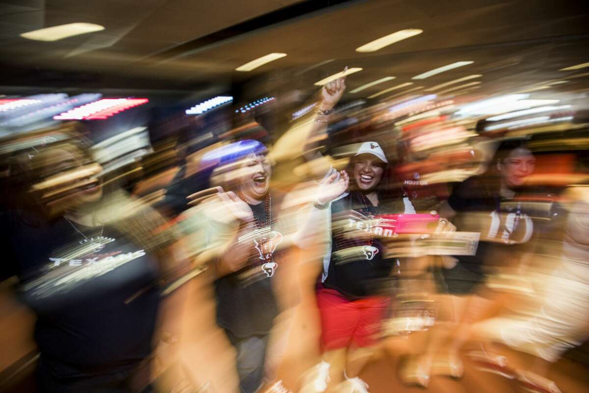 Houston Texans fans dance in the concourse during the Texans' NFL Draft party at NRG Stadium on Thursday, April 27, 2017, in Houston. ( Brett Coomer / Houston Chronicle )