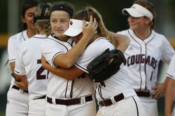 Cinco Ranch's Amanda Bondy, right, is comforted by teammate, Isabelle McKiernan, as she was pulled in the fifth inning after giving up four runs during the Class 6A bi-district softball playoffs between Ridge Point and Cinco Ranch High Schools at Stratford High School, Thursday, April 27, 2017, in Houston. ( Karen Warren / Houston Chronicle )