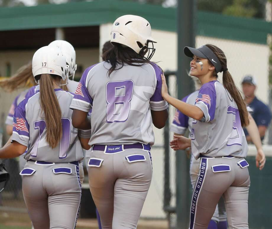 Ridge Point's Taylor Roman celebrates with Taylor Soanes (3) after hitting a three-run home run in the fifth inning during the Class 6A bi-district softball playoffs between Ridge Point and Cinco Ranch High Schools at Stratford High School, Thursday, April 27, 2017, in Houston. ( Karen Warren / Houston Chronicle ) Photo: Karen Warren/Houston Chronicle