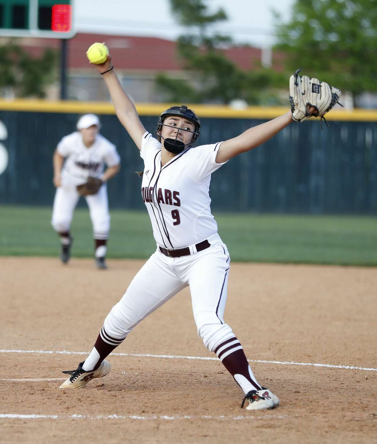 Cinco Ranch's Aliana Marroquin pitches in relief in the third inning during the Class 6A bi-district softball playoffs between Ridge Point and Cinco Ranch High Schools at Stratford High School, Thursday, April 27, 2017, in Houston. ( Karen Warren / Houston Chronicle )
