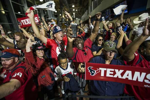 Houston Texans fans cheer as the Texans trade up to select quarterback Deshaun Watson in the NFL football draft, during a watch party Thursday, April 27, 2017, in Houston. (Brett Coomer/Houston Chronicle via AP)