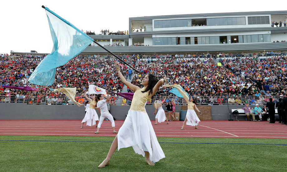 "MacArthur High School Color Guard member Lia Cuevas and others perform during the 79th annual Battle of Flowers Association Band Festival ""Blazing Trails!"" held Thursday April 27, 2017 at Alamo Stadium. Photo: Edward A. Ornelas, San Antonio Express-News / © 2017 San Antonio Express-News"