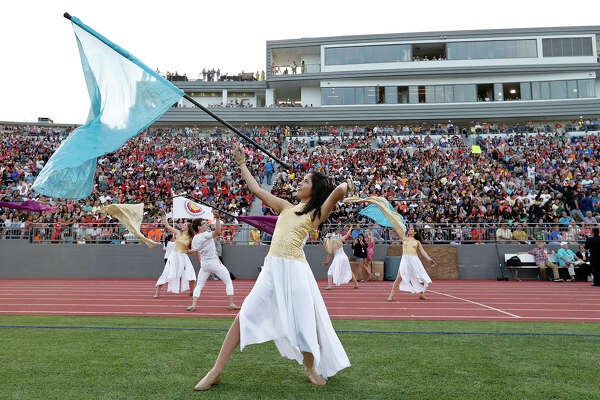 """MacArthur High School Color Guard member Lia Cuevas and others perform during the 79th annual Battle of Flowers Association Band Festival """"Blazing Trails!"""" held Thursday April 27, 2017 at Alamo Stadium."""