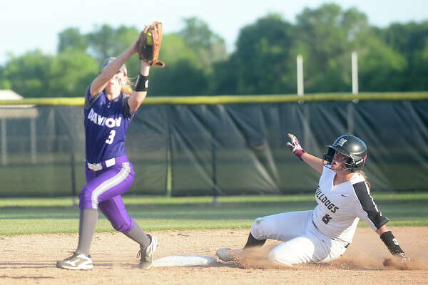 Nederland's Lexi Eversole slides safely into second ahead of the throw to Dayton's Sarah Ashby in their first best-of-three game series at home Thursday. Photo taken Thursday, April 27, 2017 Kim Brent/The Enterprise