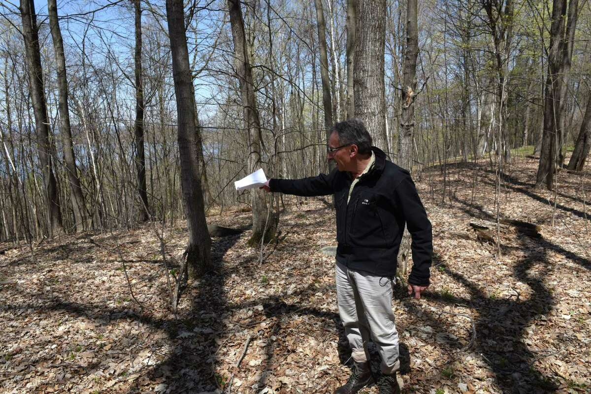 Dr. Tom Yannios stands at the edge of his property where a proposed development is planned on Hill Road on Monday, April 24, 2017, in Stillwater, N.Y. Neighbors are upset with developer John Witt?'s plans to clear cut trees from the property. They believe that it would create an ecological disaster for the lake and water table. (Will Waldron/Times Union)