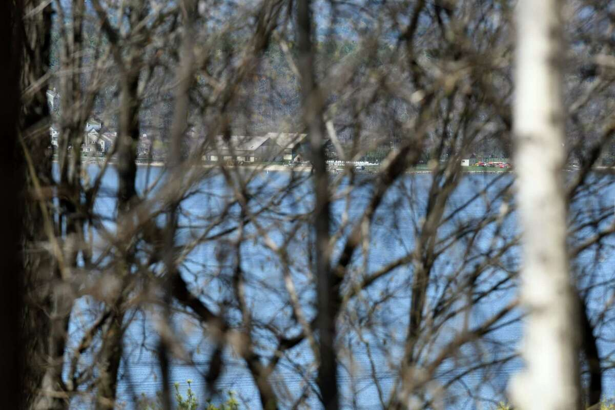 View of Saratoga Lake from land at the border of a proposed development on Hill Road on Monday, April 24, 2017, in Stillwater, N.Y. Neighbors are upset with developer John Witt?'s plans to clear cut trees from the property. They believe that it would create an ecological disaster for the lake and water table. (Will Waldron/Times Union)