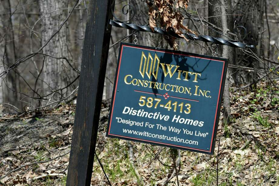 A Witt Construction sign is posted at the end of Hill Road where a development is proposed on Monday, April 24, 2017, in Stillwater, N.Y. Neighbors are upset with developer John Witt's plans to clear cut trees from the property. They believe that it would create an ecological disaster for the lake and water table. (Will Waldron/Times Union) Photo: Will Waldron / 20040338A