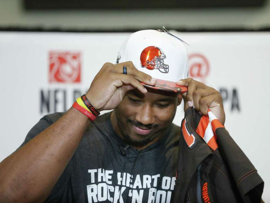 Texas A&M product Myles Garrett puts on a Cleveland hat at a watch part in Arlington. He's the first Aggie to be the first pick. Photo: Nathan Hunsinger / Dallas Morning News / The Dallas Morning News