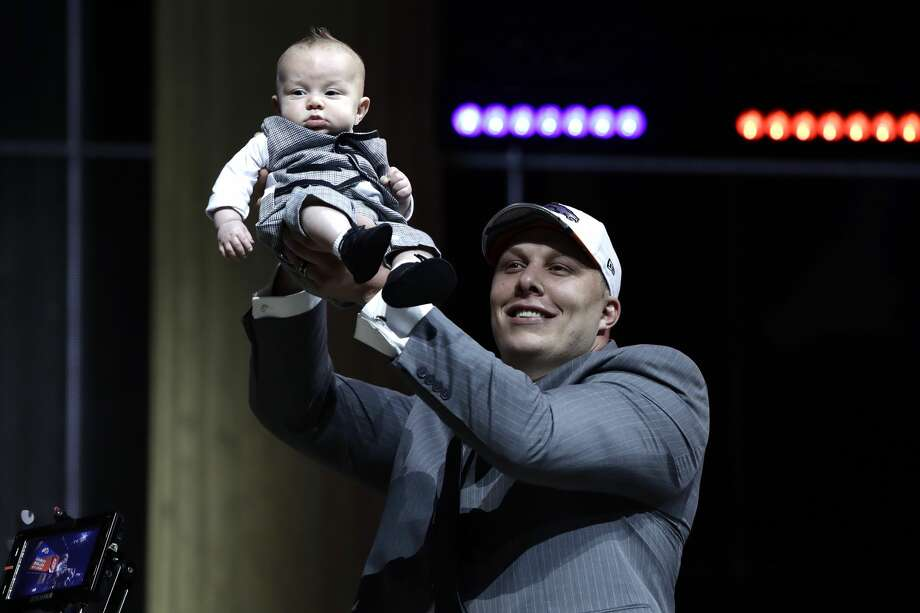 Utah's Garett Bolles holds up his son, Kingston, after being selected by the Denver Broncos during the first round of the 2017 NFL football draft, Thursday, April 27, 2017, in Philadelphia. (AP Photo/Matt Rourke) Photo: Matt Rourke/Associated Press