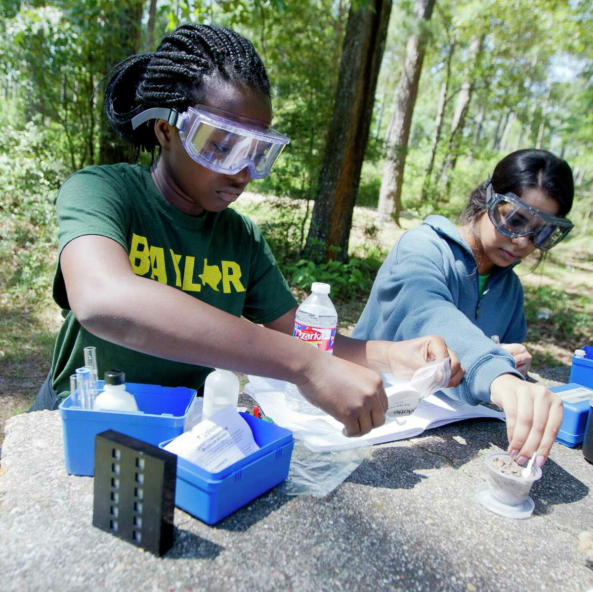 Maggie Asare and Miya Gadeam test soil samples as they and other students from the Academy of Science and Technology at College Park High School conducted various environment experiments at William Goodrich Jones State Forest, Thursday, April 27, 2017, in Conroe.