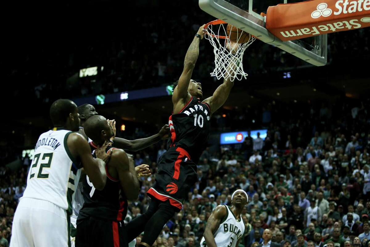 MILWAUKEE, WI - APRIL 27: DeMar DeRozan #10 of the Toronto Raptors dunks the ball in the fourth quarter against the Milwaukee Bucks in Game Six of the Eastern Conference Quarterfinals during the 2017 NBA Playoffs at BMO Harris Bradley Center on April 27, 2017 in Milwaukee, Wisconsin. NOTE TO USER: User expressly acknowledges and agrees that, by downloading and or using this photograph, User is consenting to the terms and conditions of the Getty Images License Agreement. (Photo by Dylan Buell/Getty Images) ORG XMIT: 700034580