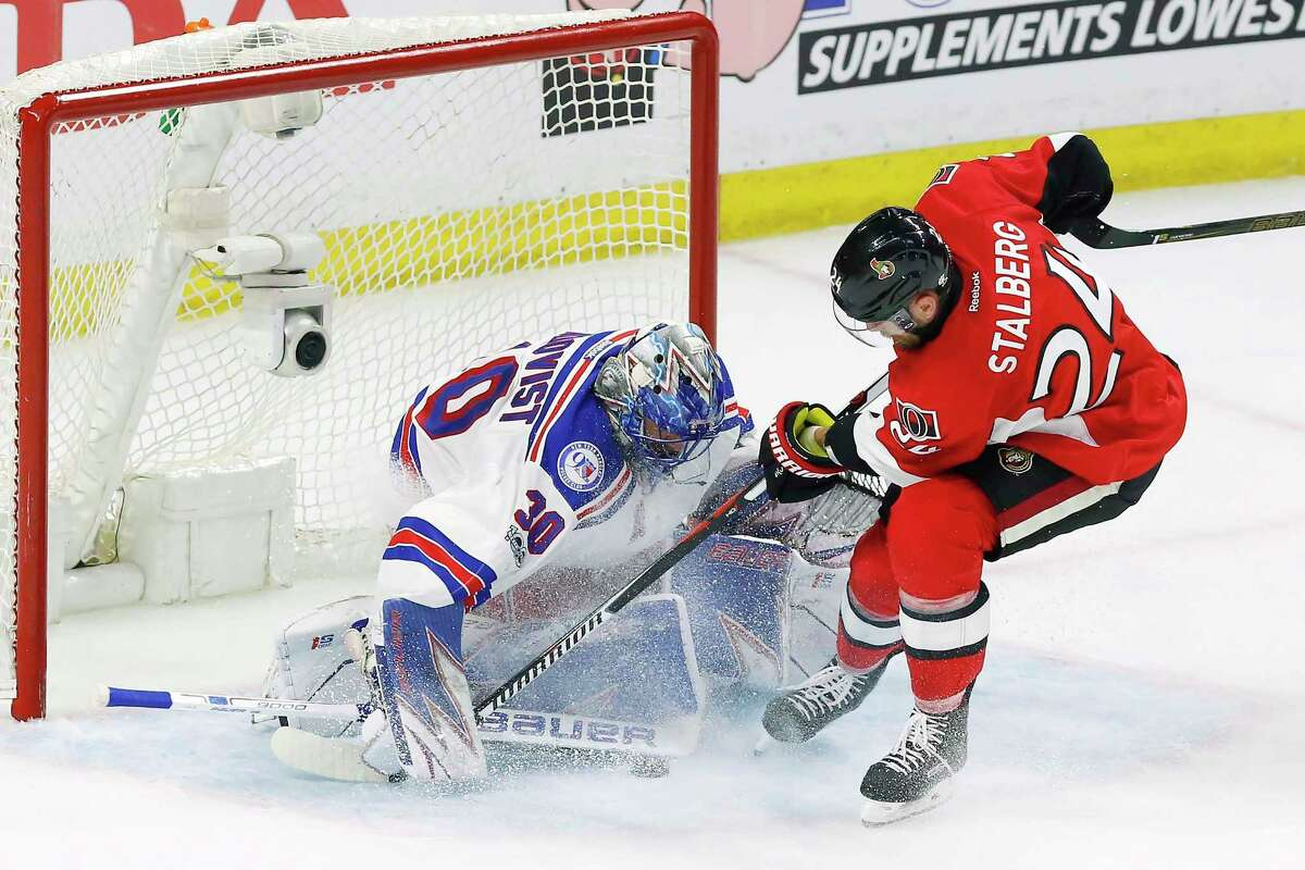 New York Rangers goalie Henrik Lundqvist (30) makes a save against Ottawa Senators left wing Viktor Stalberg (24) during the first period of Game 1 of an NHL hockey second-round playoff series, Thursday, April 27, 2017, in Ottawa, Ontario. (Fred Chartrand/The Canadian Press via AP) ORG XMIT: FXC503