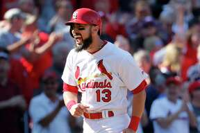 St. Louis Cardinals' Matt Carpenter celebrates as he rounds the bases after hitting a walk-off grand slam to defeat the Toronto Blue Jays 8-4 in 11 innings in the first baseball game of a doubleheader Thursday, April 27, 2017, in St. Louis. (AP Photo/Jeff Roberson) ORG XMIT: MOJR120