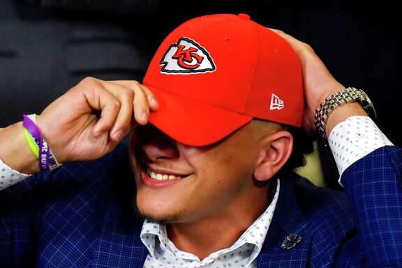 Patrick Mahomes II smiles as he puts on a Kansas City Chiefs hat for the first time during an NFL Draft watch party at Lago del Pino in Tyler, Texas, on Thursday, April 27, 2017. Mahomes II was the tenth overall pick in the first round of the NFL draft for the Kansas City Chiefs after a trade with the Buffalo Bills. (Chelsea Purgahn/Tyler Morning Telegraph)