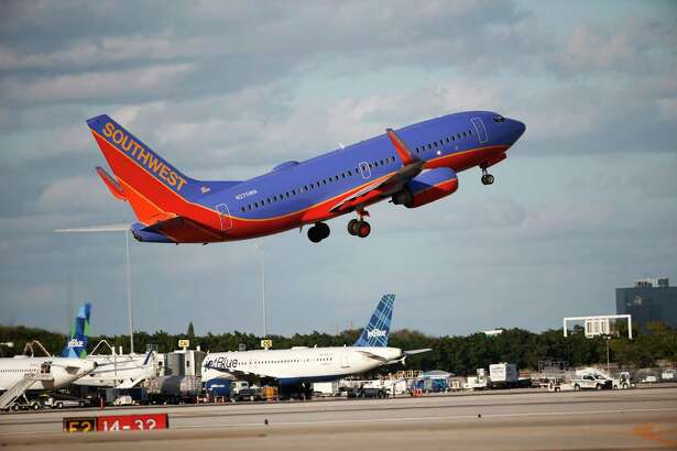Southwest says its first-quarter earnings fell  32 percent as it flew more passengers but that it  took in less revenue on average from each one.