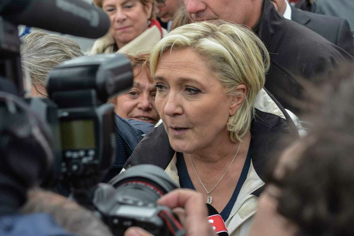 French far-right leader and candidate for the presidential election Marine le Pen answers reporters after a sea trip in Grau-du-Roi, southern France, Thursday April 27, 2017. After
