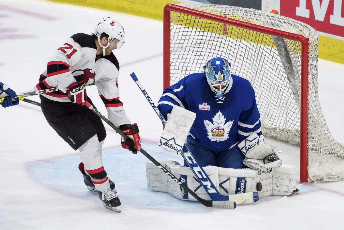 Albany Devils center Kevin Rooney moves in on Toronto Marlies goalie Kasimir Kaskisuo in Game 3 of the AHL playoff series Wednesday, April 26, 2017, at Toronto. (Courtesy of Toronto Marlies)