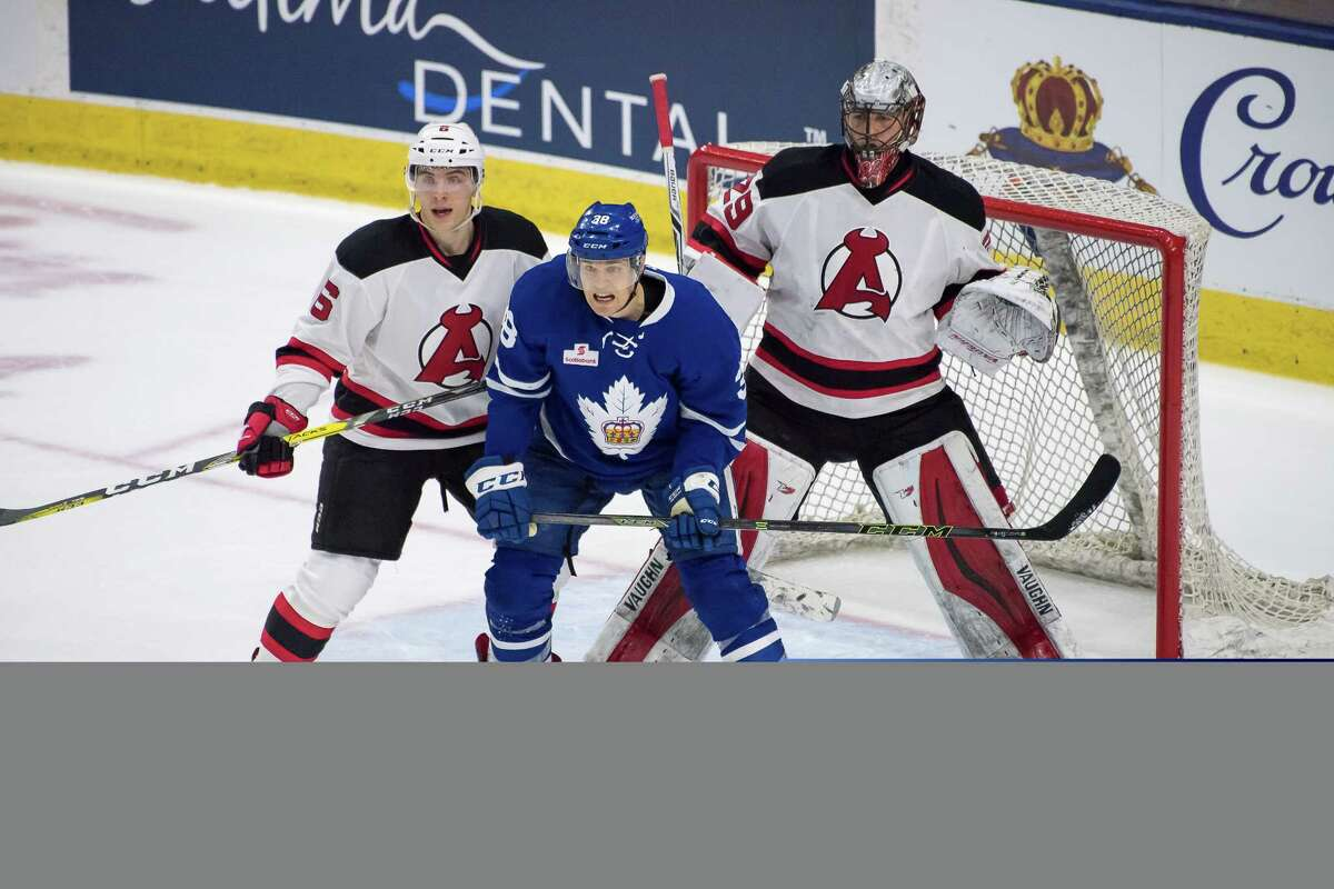 Albany Devils defenseman Steven Santini tries to move Toronto Marlies forward Colin Greening from in front of the net, where rookie goaltender Mackenzie Blackwood protects the net. Greening scored in overtime of Game 3 on Wednesday, April 26, 2017, as the Marlies beat the Devils 3-2 in the AHL playoffs. (Courtesy of Toronto Marlies)