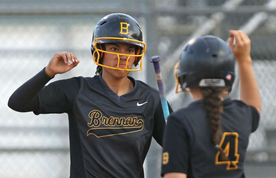 Brennan's Alexia Camacho (left) celebrates with teammate Christina Michel after scoring a run in Game 1 of the Class 6A bidistrict playoff series against Smithson Valley on April 27,2017 Photo: Ron Cortes /For The Express-News / Freelance