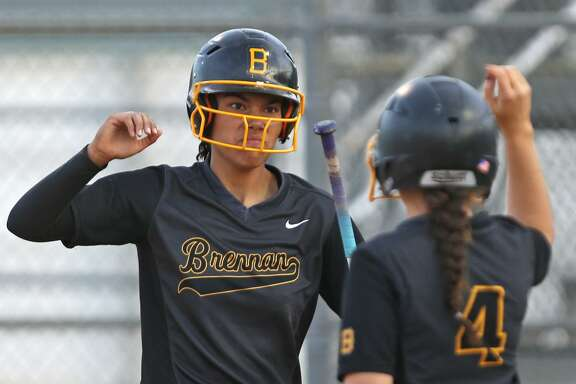 Brennan's Alexia Camacho (left) celebrates with teammate Christina Michel after scoring a run in Game 1 of the Class 6A bidistrict playoff series against Smithson Valley on April 27,2017
