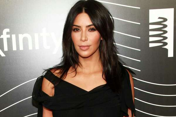 """FILE - In this May 16, 2016 file photo, Kim Kardashian West attends the 20th Annual Webby Awards in New York. Kardashian who has been laying low in a New York City apartment building since her robbery at gunpoint in Paris in October, breaks her silence in a new teaser for the family's reality show, """"Keeping Up with the Kardashians,"""" returning in March. (Photo by Andy Kropa/Invision/AP, File) ORG XMIT: NYET535"""