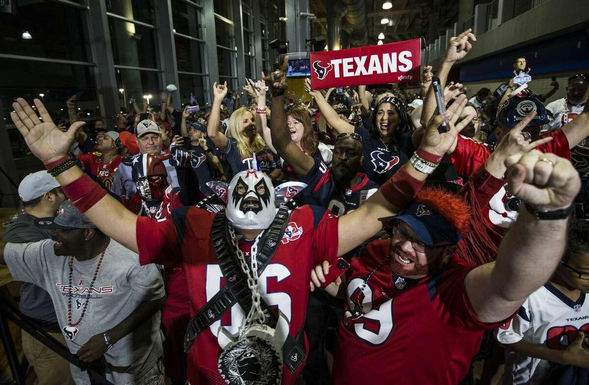 Houston Texans fans cheer as the Texans trade up to select quarterback Deshaun Watson in the NFL football draft, Thursday, April 27, 2017, in Houston. (Brett Coomer/Houston Chronicle via AP)