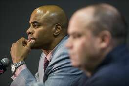 Houston Texans general manager Rick Smith, left, and head coach Bill O'Brien talk about the Texans'  selection of quarterback Deshaun Watson, of Clemson, in the NFL Draft at NRG Stadium on Thursday, April 27, 2017, in Houston. ( Brett Coomer / Houston Chronicle )