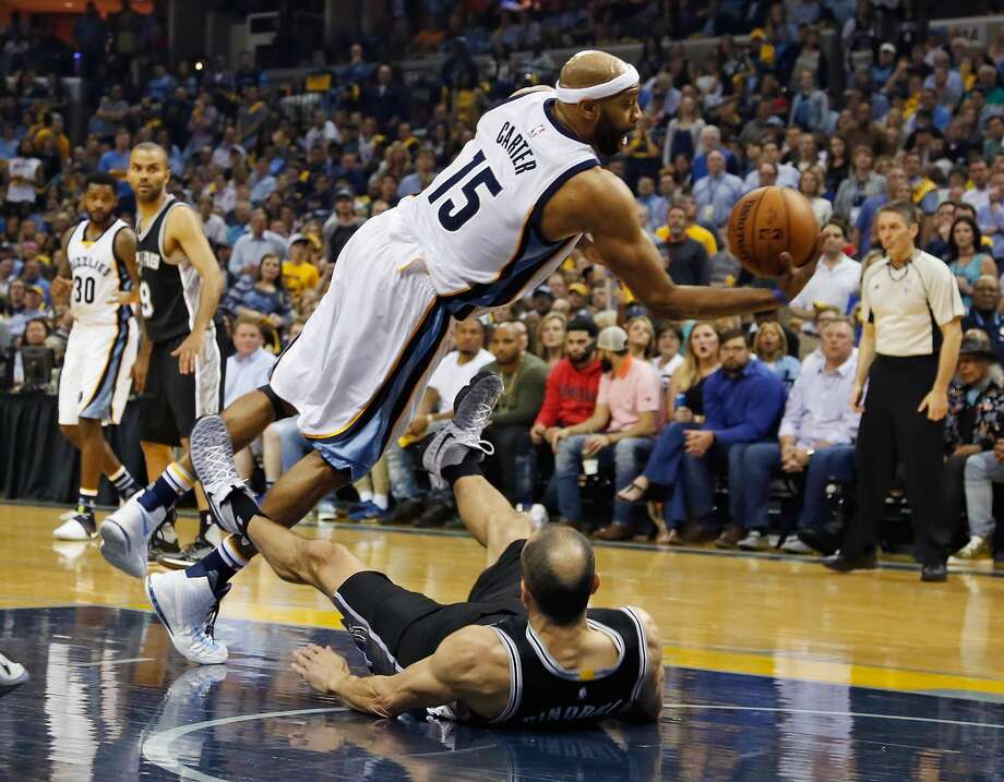MEMPHIS, TN - APRIL 27:  Vince Carter #15 of the Memphis Grizzlies collides with Manu Ginobili #20 of the San Antonio Spurs during the first half of Game 6 of the Western Conference Quarterfinals during the 2017 NBA Playoffs at FedExForum on April 27, 2017 in Memphis, Tennessee. NOTE TO USER: User expressly acknowledges and agrees that, by downloading and or using this photograph, User is consenting to the terms and conditions of the Getty Images License Agreement.  (Photo by Frederick Breedon/Getty Images) Photo: Frederick Breedon/Getty Images