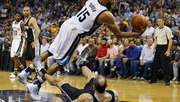 MEMPHIS, TN - APRIL 27:  Vince Carter #15 of the Memphis Grizzlies collides with Manu Ginobili #20 of the San Antonio Spurs during the first half of Game 6 of the Western Conference Quarterfinals during the 2017 NBA Playoffs at FedExForum on April 27, 2017 in Memphis, Tennessee. NOTE TO USER: User expressly acknowledges and agrees that, by downloading and or using this photograph, User is consenting to the terms and conditions of the Getty Images License Agreement.  (Photo by Frederick Breedon/Getty Images)