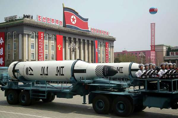 FILE - In this Saturday, April 15, 2017, file photo, a submarine-launched ballistic missile is displayed in Kim Il Sung Square during a military parade in Pyongyang, North Korea, to celebrate the 105th birth anniversary of Kim Il Sung, the country's late founder and grandfather of current ruler Kim Jong Un. North Korea observers have long marveled at the ability of a small, impoverished, autocratic nation to go toe-to-toe with the world's superpowers. (AP Photo/Wong Maye-E, File) ORG XMIT: XSEL102