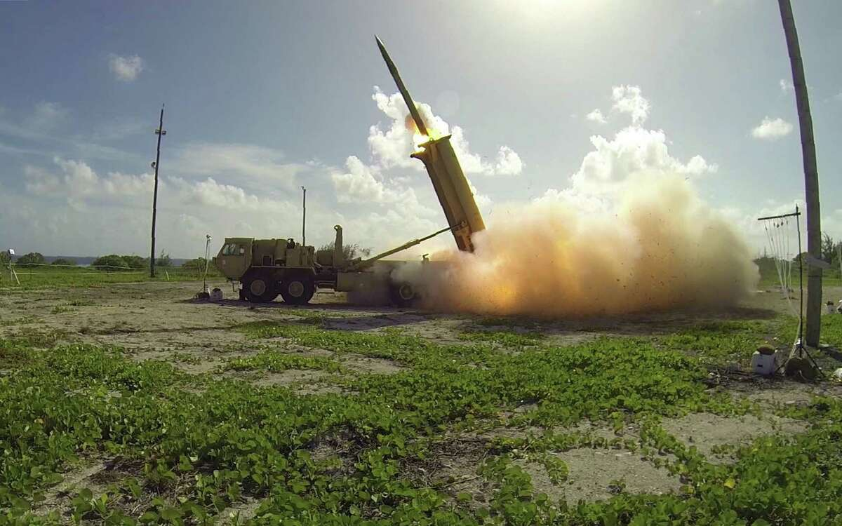 (FILES) This handout photo taken on November 1, 2015 and received by the US Department of Defense/Missile Defense Agency shows a terminal High Altitude Area Defense (THAAD) interceptor being launched from a THAAD battery located on Wake Island in the Pacific Ocean, during the Flight Test Operational (FTO)-02 Event 2a. A missile defense system that the United States has begun installing in South Korea will be operational in the coming days, a top American admiral said Wednesday. US troops began delivering the Terminal High Altitude Area Defense (THAAD) system for installation on a former golf course in the southern county of Seongju on the morning of April 26, 2017.THAAD