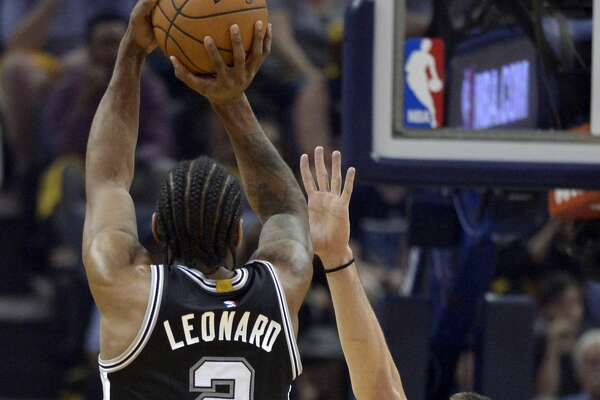 San Antonio Spurs forward Kawhi Leonard (2) shoots against Memphis Grizzlies center Marc Gasol (33) during the first half of Game 6 in an NBA basketball first-round playoff series Thursday, April 27, 2017, in Memphis, Tenn. (AP Photo/Brandon Dill)