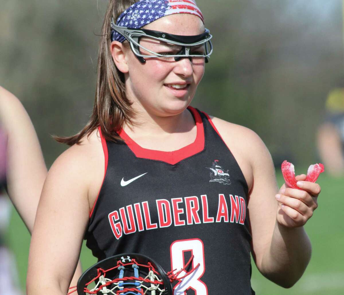 Guilderland's Hayley Kmack readies to do battle during Thursday's Suburban Council girls' lacrosse matchp at Niskayuna High School. (Ed Burke-Special to The Times Union)
