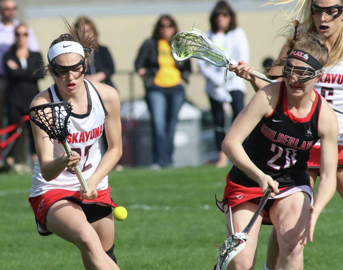 Niskayuna's Tori Pantalone chases a loose ball pressured by Guilderland's Kadi Futia during Thursday's Suburban Council girls' lacrosse matchp at Niskayuna High School. (Ed Burke-Special to The Times Union)
