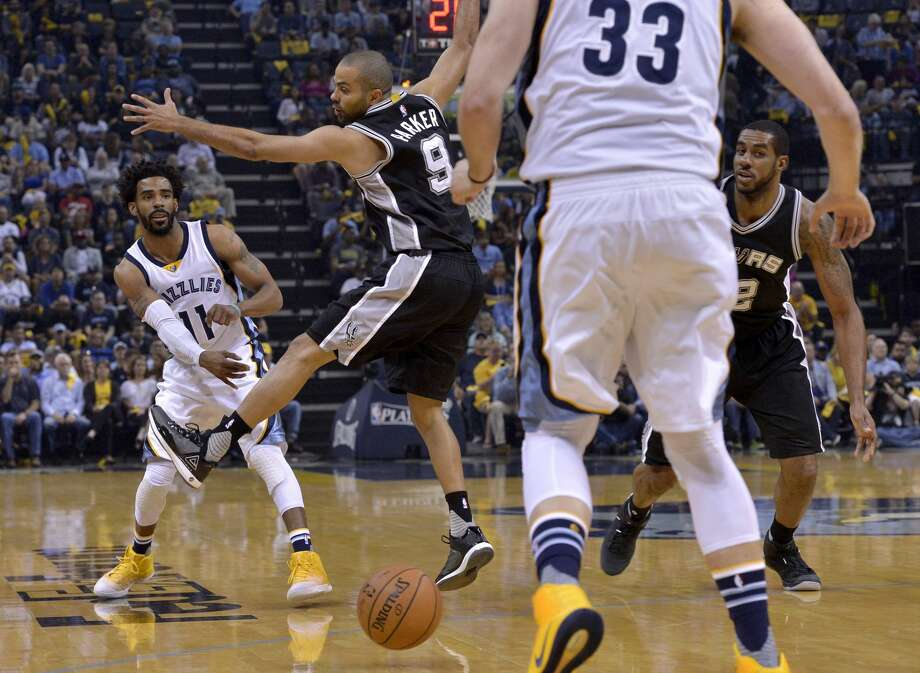 Memphis Grizzlies guard Mike Conley (11) passes to center Marc Gasol (33) past San Antonio Spurs guard Tony Parker (9) and forward LaMarcus Aldridge, right, during the first half of Game 6 in an NBA basketball first-round playoff series Thursday, April 27, 2017, in Memphis, Tenn. (AP Photo/Brandon Dill) Photo: Brandon Dill/Associated Press
