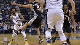 Memphis Grizzlies guard Mike Conley (11) passes to center Marc Gasol (33) past San Antonio Spurs guard Tony Parker (9) and forward LaMarcus Aldridge, right, during the first half of Game 6 in an NBA basketball first-round playoff series Thursday, April 27, 2017, in Memphis, Tenn. (AP Photo/Brandon Dill)