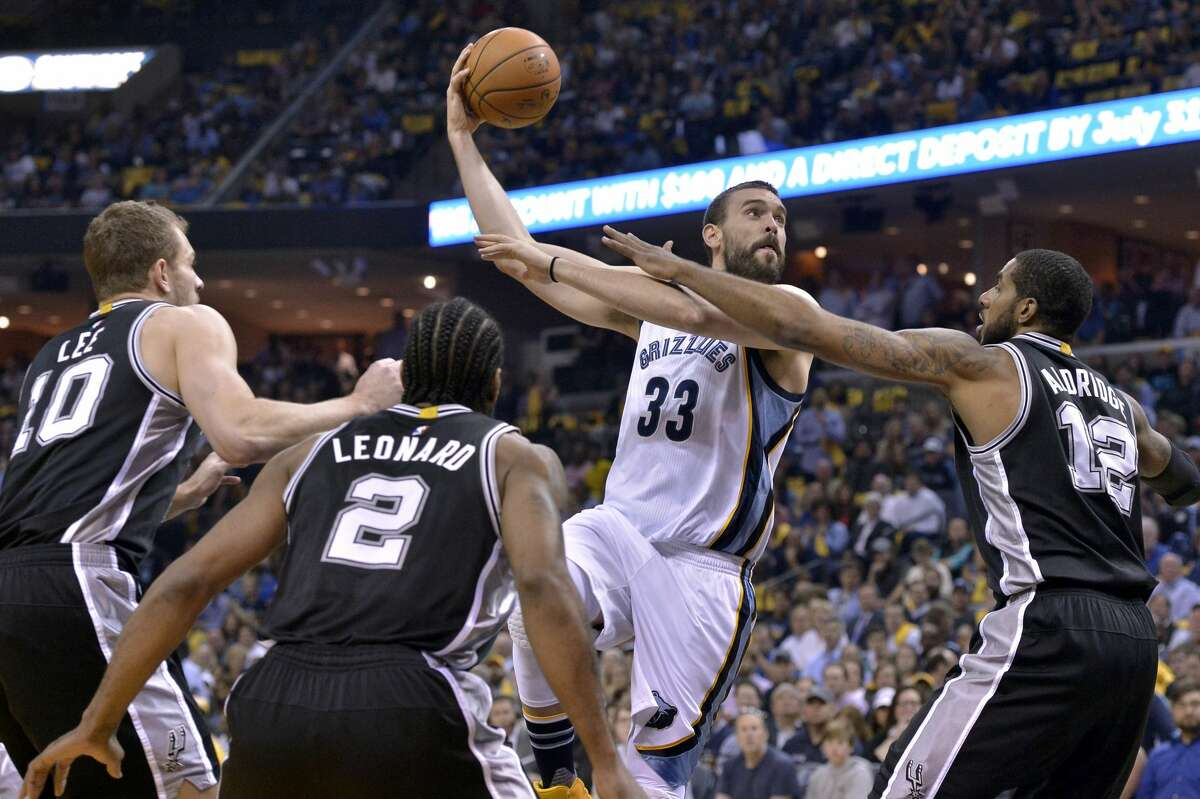 Memphis Grizzlies center Marc Gasol (33) shoots between San Antonio Spurs forwards David Lee (10), Kawhi Leonard (2), LaMarcus Aldridge (12) during the first half of Game 6 in an NBA basketball first-round playoff series Thursday, April 27, 2017, in Memphis, Tenn. (AP Photo/Brandon Dill)